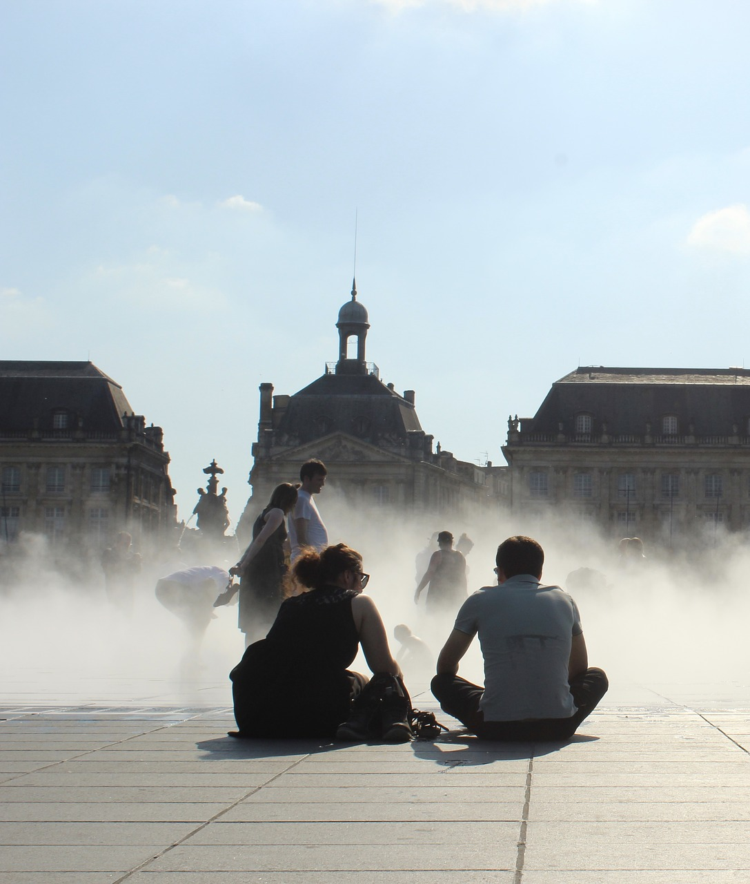 Students sitting close to the Miroir d'Eau in Bordeaux